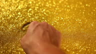 hand writing 2015 on golden sand background video