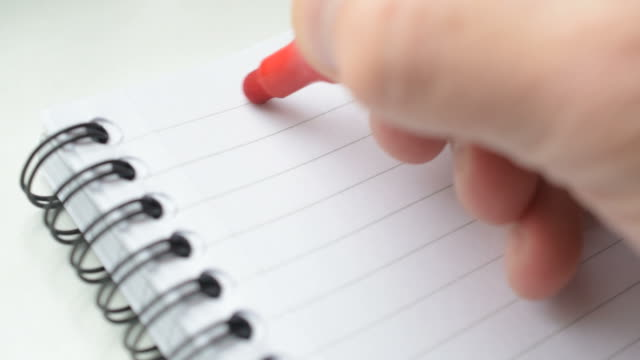 Hand writing GOALS with red marker in notepad video