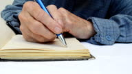 Hand writing in notebook video