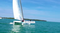 HD Handheld: Handheld Shot of Young Boats-man Leaning on Catamaran video