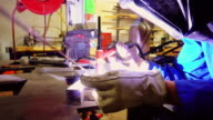 Handheld Shot Approaching Woman Using Welder video