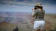 Handheld Shot of Woman Looking At Grand Canyon video