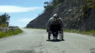 Handicapped Man On Mountain Pathway video