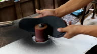 Handmade shoe soles on sander video