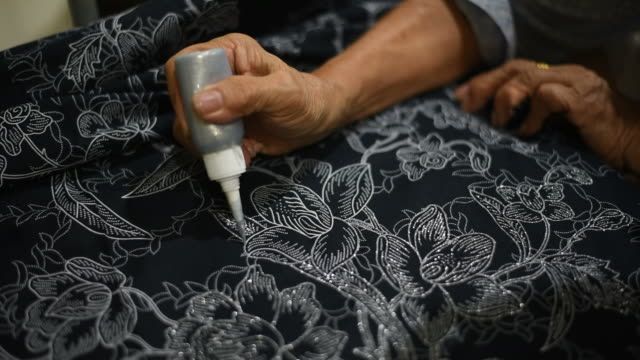 Handmade textile ,painting the patterns for batik. video