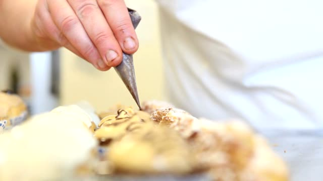 hands baker decorate pastries video
