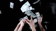 Hands Catching Falling Dollars (Super Slow Motion) video