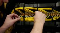 hands checks the server rack video