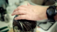 Hands close bank with inedible mass by kitchen rolls machine. Art house cooking video