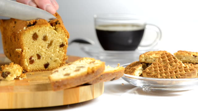 Hands cut cake with raisin on a chopping board a sharp knife video