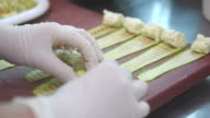 Hands female chefs making rolls with cheese and zucchini video