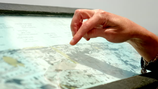 Hands forefingers pointing the places on touristic map video