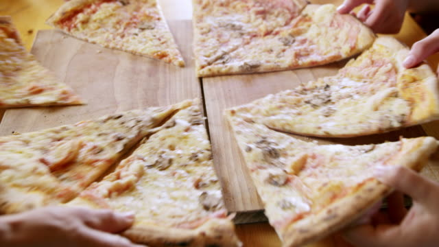 MS Hands grabbing pieces of pizza video