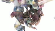Hands grasping at falling Canadian money video
