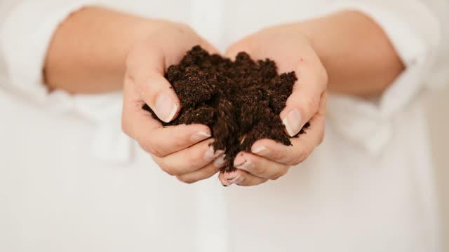 Hands holding black Soil video