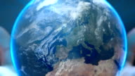 Hands holding earth globe video