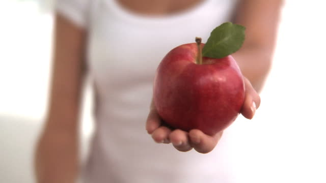 Hands holding red and green apples video