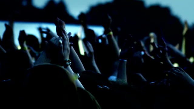 Hands in air at concert video