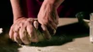 Hands kneading a dough video