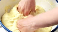 Hands kneading a dough video
