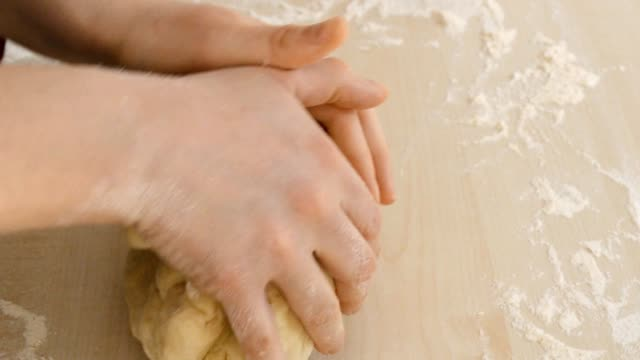 hands kneading bread video