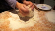hands kneading dough in flour on table video