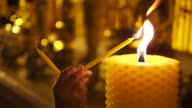 Hands Lighting Candles at Buddhist Temple in Chiang Mai, Thailand video