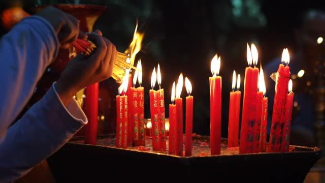 Hands Lighting Incense Sticks at Jade Emperor Pagoda, Ho Chi Minh City, Vietnam video