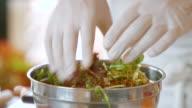 Hands mix salad. video