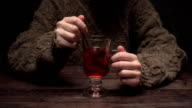Hands mixing mulled wine video