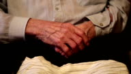 Hands of 93-year old man after two cerebral strokes video