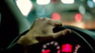 Hands of a man driving a car. Close up video