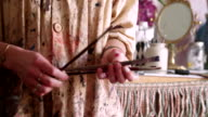 Hands of an artist wearing a traditional smock holding paintbrushes video