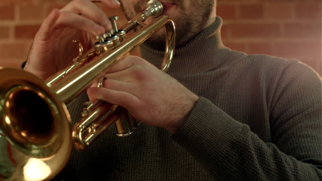 Hands of an musician playing the trumpet video