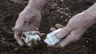 SLO MO Hands of bankrupt farmer video