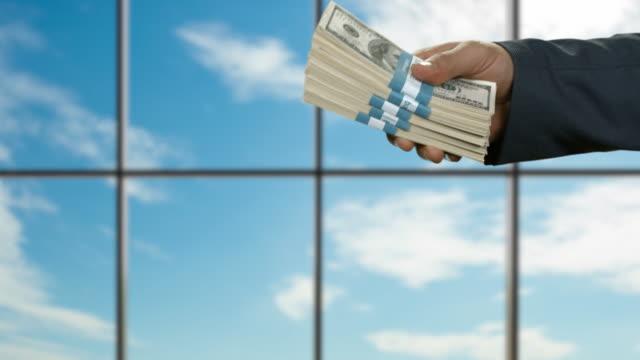 Hands of businessmen pass dollars. video