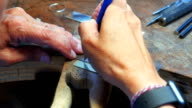 Hands of craftswoman working in workshop video