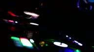 Hands of DJ tweak various track controls on dj's deck video