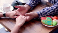 Hands of Happy loving couple. Gently caress, rub. Cookies and tea on the table video