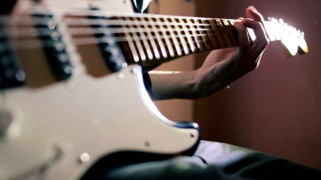 Hands of man playing electric guitar. Bend technique. rock musician video