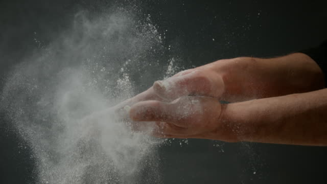 Hands of Man with Flour, Slow motion 4K video