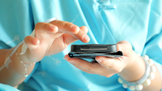 Hands of patient using smartphone,Close-up video
