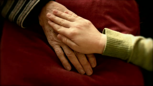 Hands of senior woman and her grandchildren video