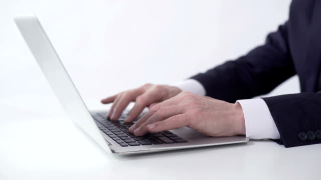 Hands of successful businessman typing on laptop, working on project report video