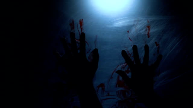 Hands of suffocating victim leaving trace of blood, person suffering from pain video
