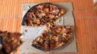 Hands Of The People Take To Pieces Of Pizza video