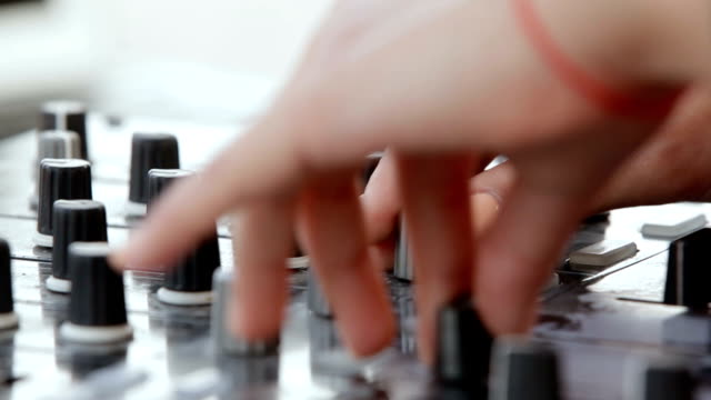 hands of woman Dj play music on mixing console video