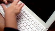 Hands of young child typing on keyboard video
