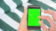 Hands on a smart phone CHROMA KEY video
