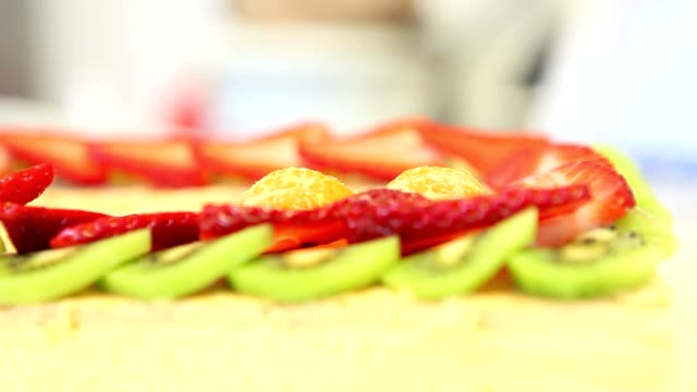 hands pastry chef prepares a fruit cake video